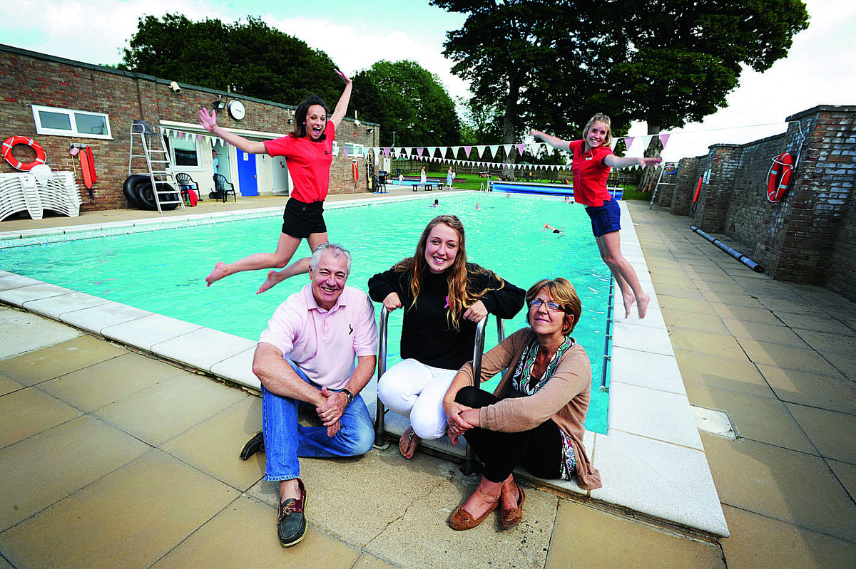 Stepfather Gary Creese, sister Hattie Creese, 16, and mother Maggi, at The Lido in Chipping Norton, one of the causes to benefit from the charity set up in Emma's name. Behind are lifeguards Georgia Allen, left, and Megan Wood   Picture OX68069 Jon Lewi