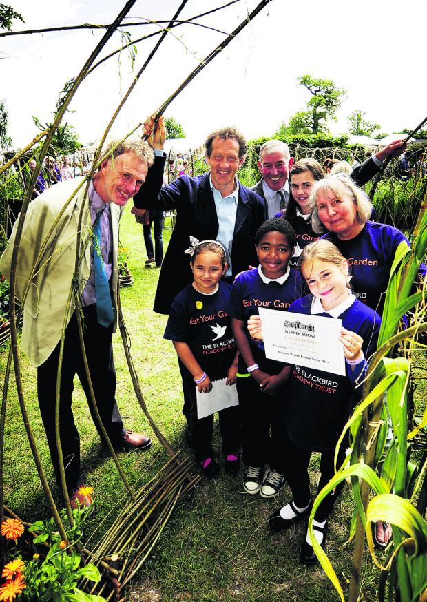 Oxford Mail: Back, from left, Tim Miles, head gardener at Cotswold Wildlife Park, Monty Don, Jim Buttress, Bethany Mayhew, 10, and Blackbird Leys Academy executive head Jill Hudson. Front, Lorena Babie, seven, Alexander Clovis, 11, and Anita Begu, 10 Picture: OX68057