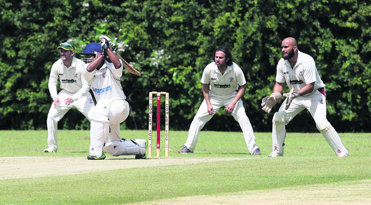 Charlbury's Bimalka Liyanarachchi drives a four against Cowley Internationals   Pictures: Steve Wheeler Order no: OX68054