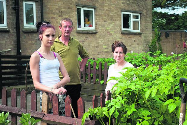 Oxford Mail: From left, residents Laura Berry, Andrew Samuel and Deborah Cox by the garden                                  	        Picture: OX68142 Andrew Walmsley