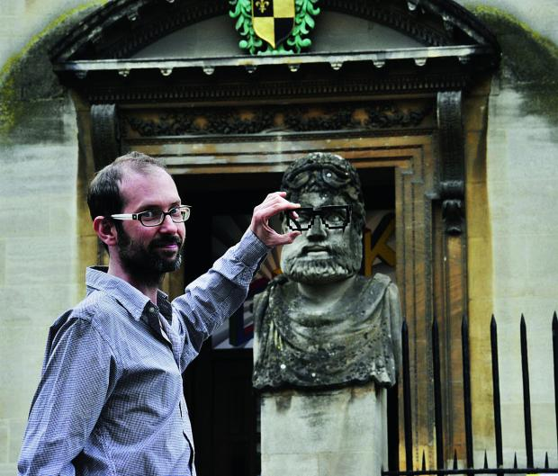 Scott Billings of the Museum of Science in Oxford shows where the Geek Specs had been placed – the new pair come courtesy of digital technology. The specs have been stolen from the two stone heads outside the building and there is an appeal for their sa