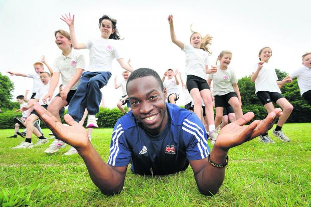 Oxford Mail: Triple jumper Michael Puplampu visited Longworth Primary School where he was guest of honour at the sports day