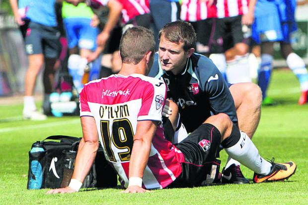 Oxford Mail: Andrew Proctor (right) in action as Exeter's physio