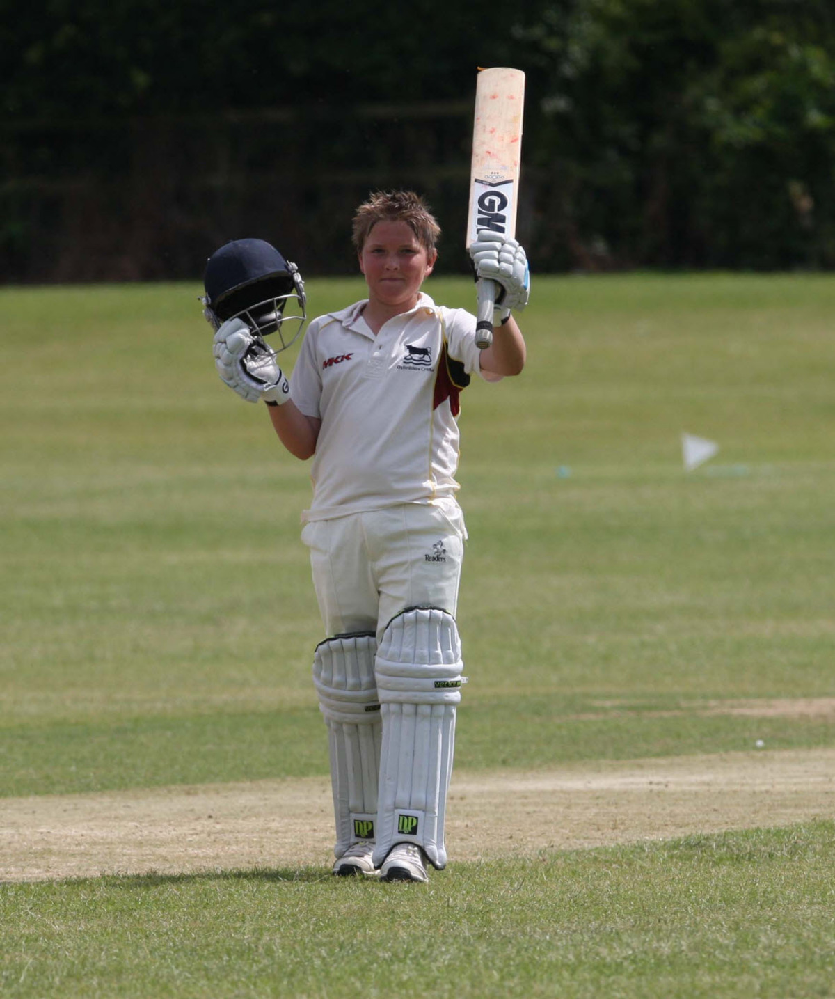 James Coles celebrates his century for Oxfordshire Under 10s against Buckinghamshire