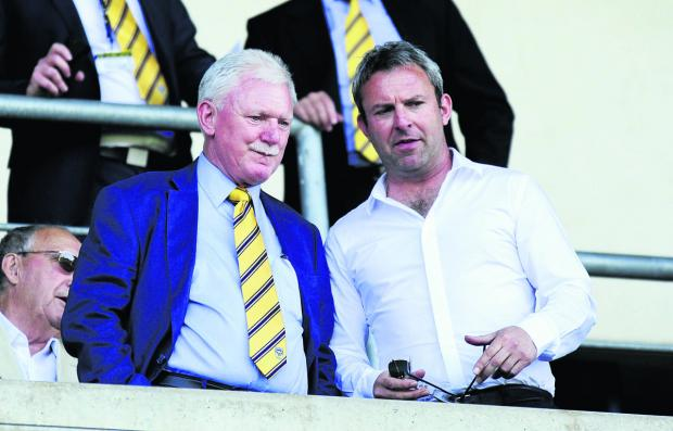 Oxford Mail: Oxford United owner Ian Lenagan with Simon at a U's game last season