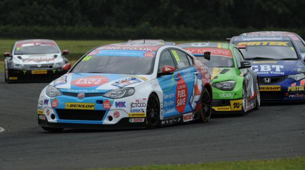 Jason Plato is chased by Rob Collard in race one at Croft Picture: Lee Foxon