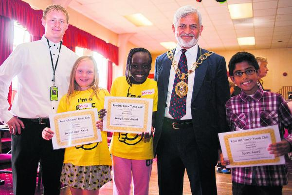 Pictured with lead playworker Jamie Bourton, left, and Lord Mayor of Oxford Mohammed Abbasi are, from left, nine-year-olds Mimi Partlett, Miriam Olayinka and Zagum Abbas after receiving their Young Leader Award certificates