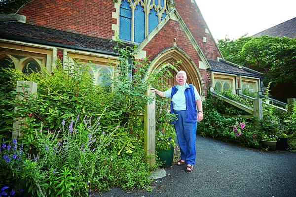 Oxford Mail: Pauline Main, Minister at Summertown United Reformed Church, pictured next to the wooden beams that are currently supporting the building