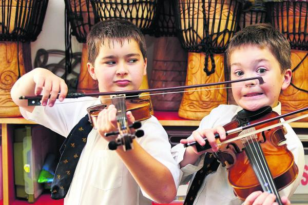 Luke Hitchcock, 11, and Toby Collier, 10, right, express their feelings with some nifty bow work
