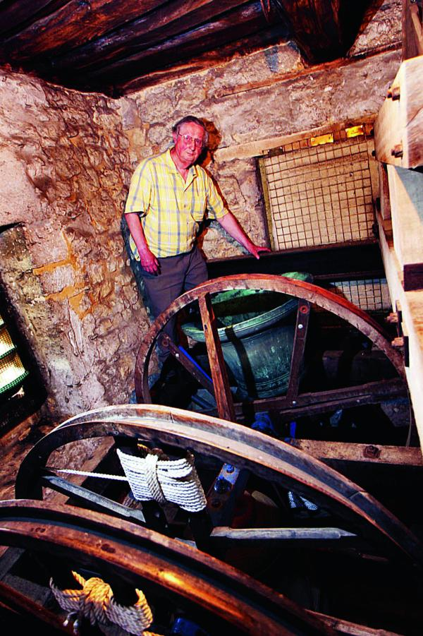 St Nicholas Church bellringer Anthony Hughes up in the tower with the biggest bell