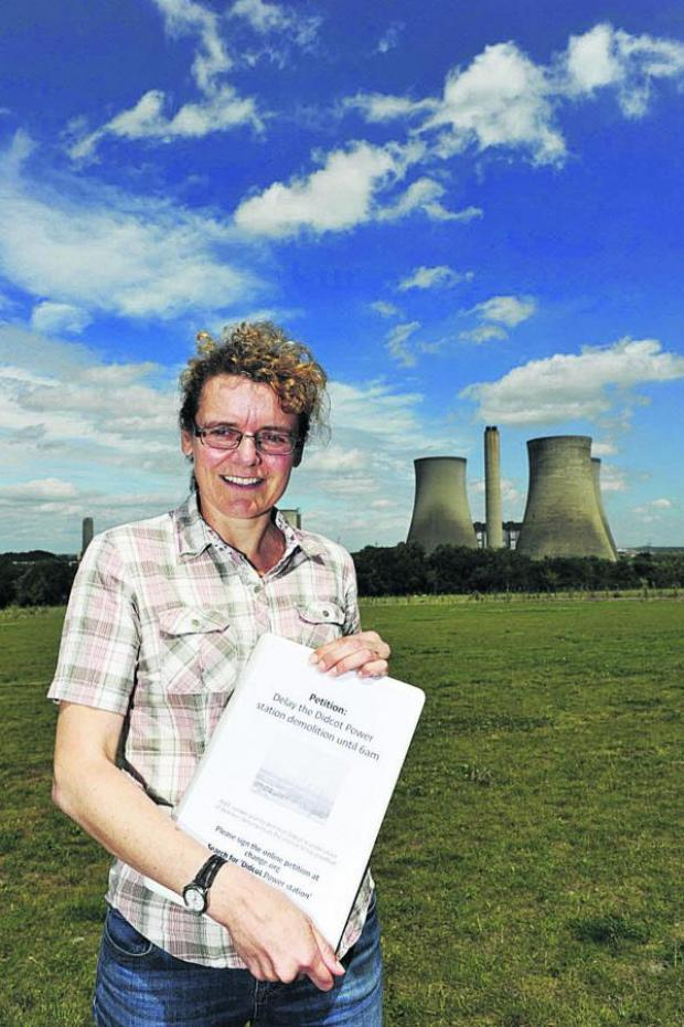 Oxford Mail: Christine Reardon with her petition about the demolition of the Didcot cooling towers. Picture: OX68423 Mark Hemsworth