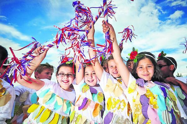 Oxford Mail: Aalya Khan, Zahra Khan, Sarah Lockhart and Michelle Latifi, all nine, of Kingfisher Class at St Francis Primary School, run through a dress rehearsal of their Morris dance for Cowley Road Carnival. Picture: OX68434 Cliff Hide