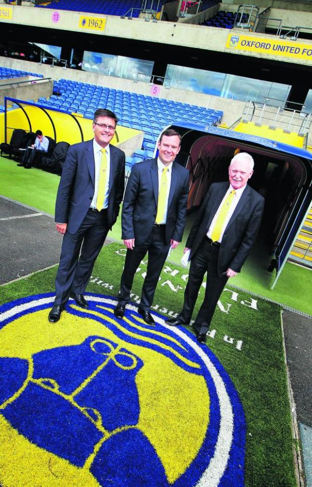 Oxford Mail: Darryl Eales (left), Mark Ashton and Ian Lenagan walk out of the Kassam Stadium tunnel after yesterday's press conference
