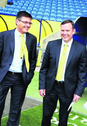 Darryl Eales (left) and Mark Ashton share a joke as they pose for pictures at the Kassam Stadium yesterday      Picture: Ed Nix