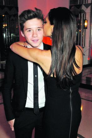 Brooklyn Beckham gets a kiss from his mum Victoria... but don't be fooled, he's not mollycoddled