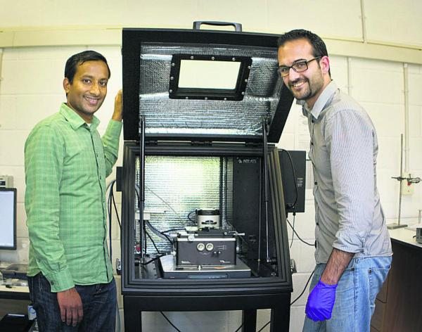 Prof Harish Bhaskaran, left, and Dr Peiman Hosseini with their equipment. Picture: OX68565 Antony Moore