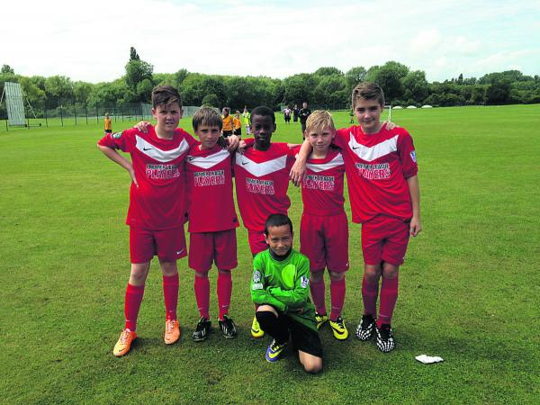 Pictured (from left): are Alfie Carter, Rueban Barresi, Connell Bob, St John Fisher School, Oxford's five-a-side team. From left: Connor Barrett, Tyler Webb, Mikolaj Thompson (kneeling)