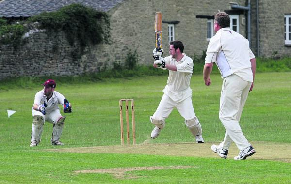 Combe's Mike Eeley hits a four in their 37-run win at home to East & West Hendred, before (below) later being caught by Charlie Mumford in the Division 2 clash