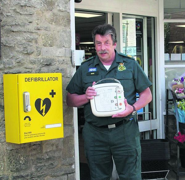 Dick Tracey from South Central Ambulance Service with a defibrillator installed in Eynsham, West Oxfordshire.  Picture: Steve Wheeler