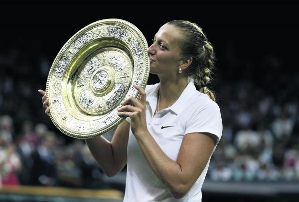 Petra Kvitova parades the winner's trophy at the Wimbledon Championships this year