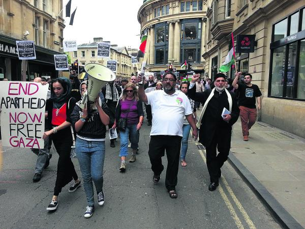 Dr Hojjat Ramzy, front second from right, director of the Oxford Islamic Information Centre, joins the protest against the war in Gaza