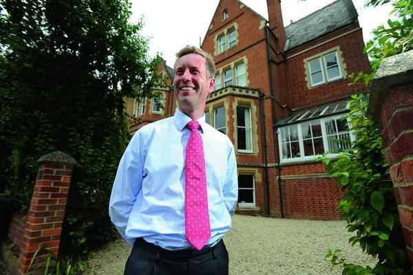 Oxford Mail: Mark Charter, head of the Carter Jonas estate agents' Oxford office, at the flat in Norham Gardens, Oxford, which is up for sale for £1.45m
