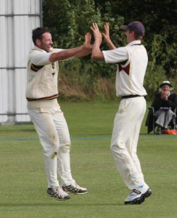 Luke Ryan celebrates a crucial catch from Michael Beard (right) in Oxfordshire's trophy semi-final victory over Wiltshire. The captain now wants to recreate that atmosphere in Oxon's Championship side
