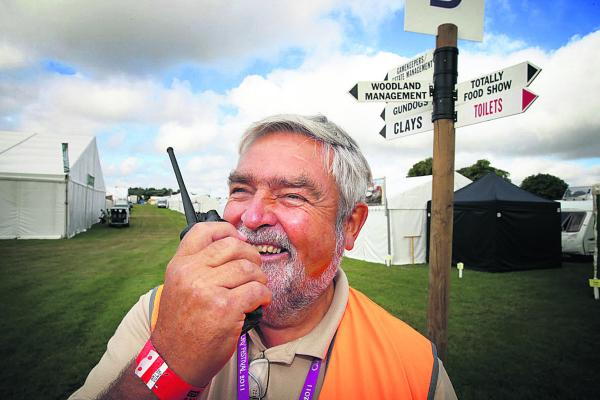 CLA Game Fair director Tony Wall keeps in touch with his team yesterday as the preparations entere