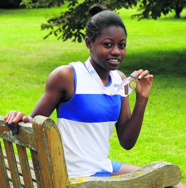 Oxfordshire's Simi Fajemisin relaxes with her medal  Picture: Steve Wheeler Order no: OX68656