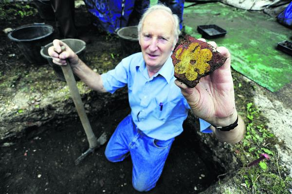 John Eaton, society member since 1973, unearths a 14th Century medieval decorated floor tile