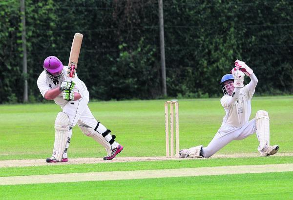Oxford Downs wicket-keeper Frankie Crouch does well to collect the ball after Twyford's Dave Powles misses with this attempted leg glance