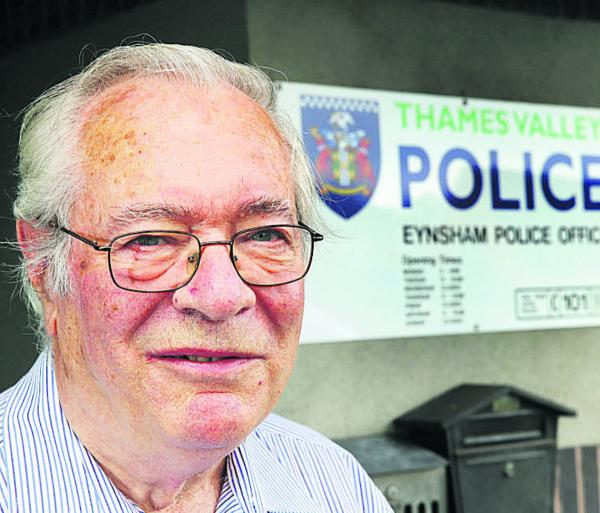Thames Valley Police Volunteer of the Year award winner, Ron Hollis who works the police counter in Eynsham Village Hall