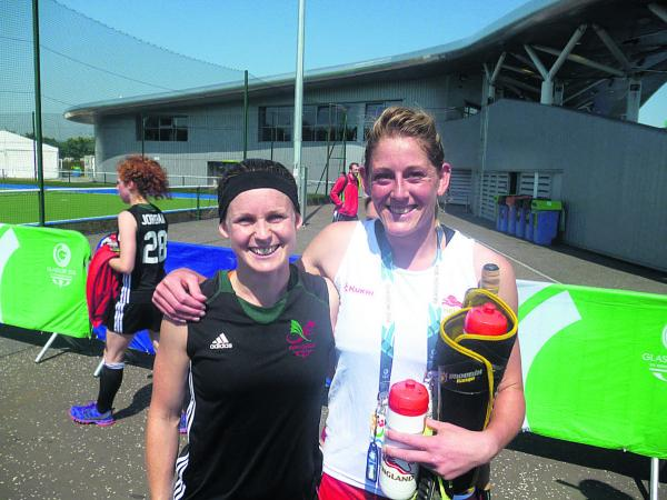 Emma Batten (left), from Wales and England's Zoe Shipperley, both of whom have Oxfordshire connections, are all smiles after yesterday's opening match