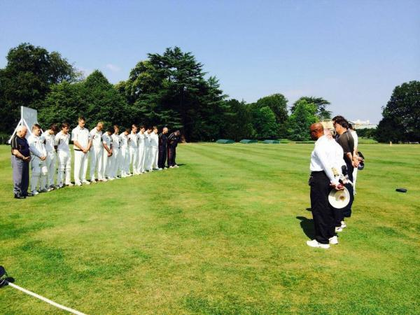 Oxfordshire Under 17s line up for a minute's silence in memory of Felix Byam Shaw before their match at Southill Park