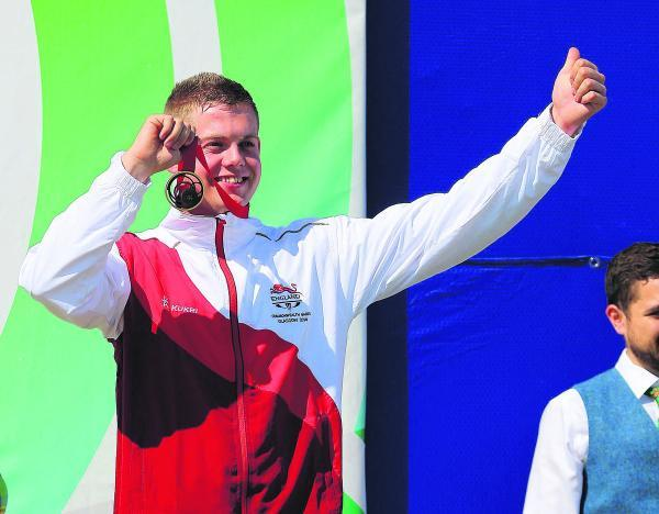 Dan Rivers celebrates his Commonwealth Games bronze medal yesterday