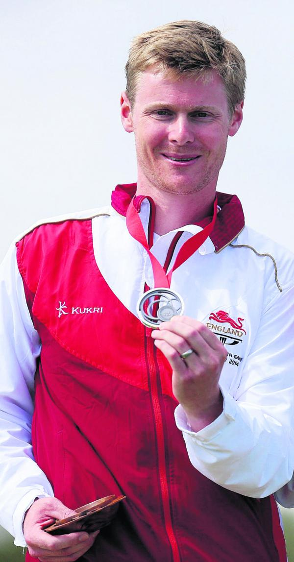 Matt French shows off his silver medal