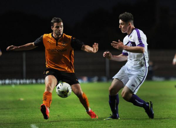 United substitute James Roberts (right) closes down Wolves's Antony Forde during last night's 1-0 defeat