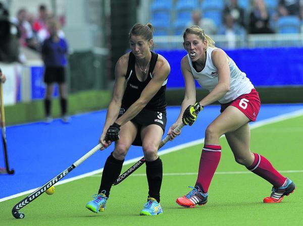 Oxfordshire's Zoe Shipperley (right) takes on New Zealand's Krystal Forgesson during yesterday's ladies hockey semi-final  Picture: Ady Kerry