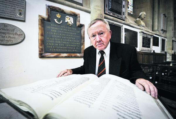 Terry Roper, chairman of the Oxford branch of the Royal Green Jackets Association, looks at a book of names at the Military Chapel, Christ Church Cathedral, St Aldate's, of soldiers who died in the First World War