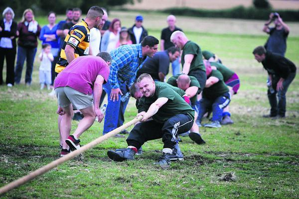 Heave: Dan Brownsill gives it his all during the challenge