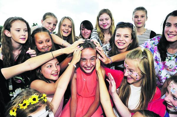BUZZ OF ACTIVITY: Shannon Timms surrounded by friends after having her hair cut short. Inset: How Shannon looked before