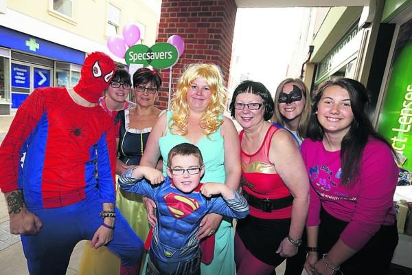Staff and volunteers at Specsavers in Abingdon who dresssed as princesses and superheroes for the fundraiser. From left: Hayden Wheable, Megan Harries, Lorraine Robinson, Charlotte Dackombe with her son, Jake, six