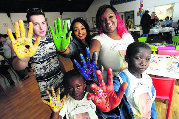 HIGH FIVES: Showing their support, from left, Bronan Ross, 18, Daquan Jack, six, Maria Gomes, 15, Tessa Jack, 21, and Devonte Jack, 10