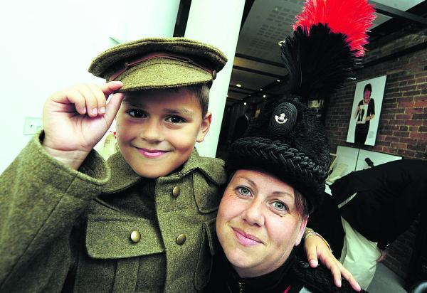 2nd Lieutenant Kaz Raffell, of the Corunna Band and Bugles, with her son Lee Ruffell, eight, in First World War uniform at the exhibition