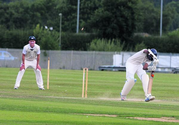 Oxford's Vishane Perera is bowled by Aston Rowant's Leo Bethell