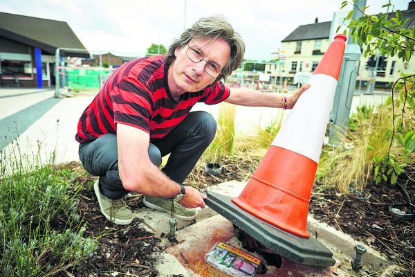 Preston Likely hides a copy of his book under a traffic cone in Didcot