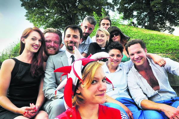 Assistant director Diana Vucane, who also plays the character Feste, is pictured front centre with other members of the Twelfth Night cast in front of the castle mound