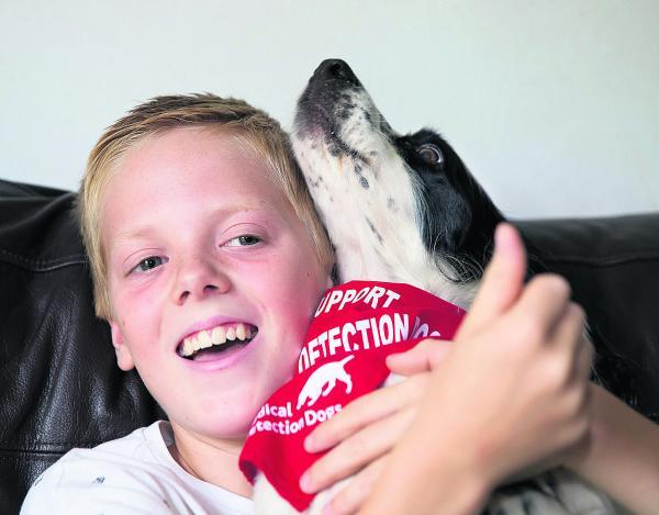 Oli Hewitt with cocker spaniel Trudy, who he rescued after she ran off and got trapped in a drain