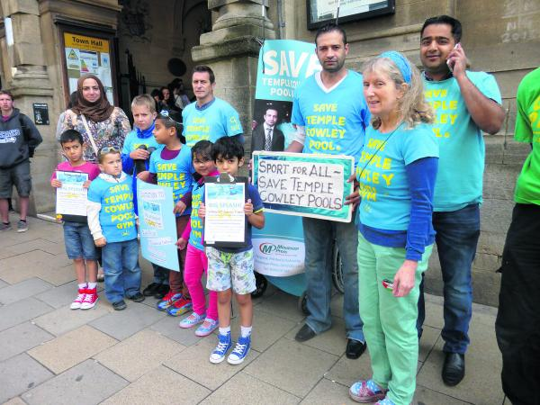Save Temple Cowley Pools campaign member Jane Alexander, right, with protesters outside Town Hall
