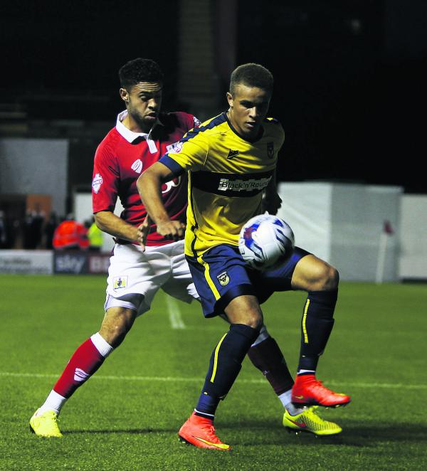 Carlton Morris, pictured holding off Bristol City's Derreck Williams in midweek, is struggling to be fit for today's trip to Mansfield after suffering a dead leg